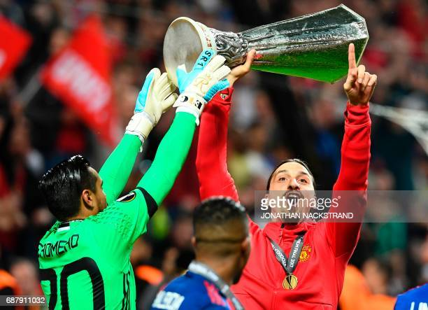 TOPSHOT Manchester United's Swedish striker Zlatan Ibrahimovic celebrates with the trophy after the UEFA Europa League final football match Ajax...
