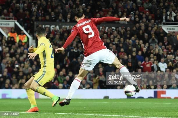 Manchester United's Swedish striker Zlatan Ibrahimovic does a backward flick to lay the ball off for Manchester United's Spanish midfielder Juan Mata...