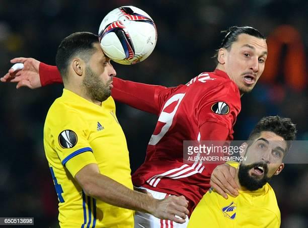 TOPSHOT Manchester United's Swedish striker Zlatan Ibrahimovic fights for the ball with Rostov's Moldovan midfielder Aleksandr Gatskan and Rostov's...