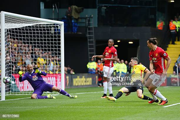 Manchester United's Swedish striker Zlatan Ibrahimovic has a shot on goal during the English Premier League football match between Watford and...