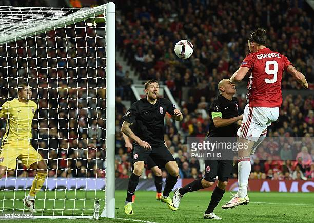 Manchester United's Swedish striker Zlatan Ibrahimovic heads the ball to scores his team's first goal during the UEFA Europa League group A football...