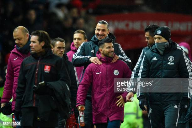 Manchester United's Swedish striker Zlatan Ibrahimovic jokes with Manchester City's Argentinian striker Sergio Aguero ahead of the English Premier...