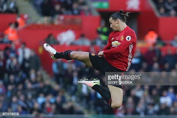 Manchester United's Swedish striker Zlatan Ibrahimovic jumps and kicks the air as he celebrates scoring his team's second goal during the English...