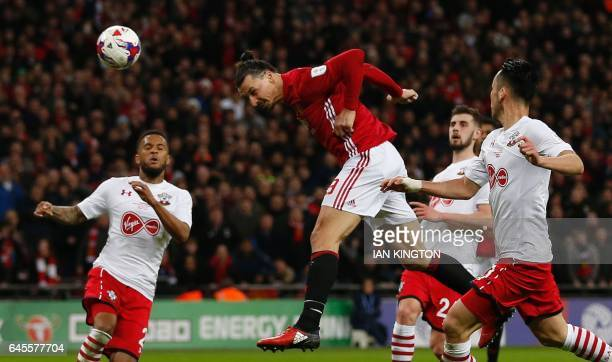 Manchester United's Swedish striker Zlatan Ibrahimovic jumps to head their third goal during the English League Cup final football match between...