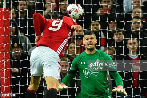 TOPSHOT Manchester United's Swedish striker Zlatan Ibrahimovic jumps to head their third goal past Southampton's English goalkeeper Fraser Forster...