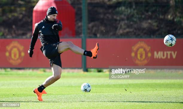 Manchester United's Swedish striker Zlatan Ibrahimovic kicks the ball during a team training session at the club's training complex near Carrington...