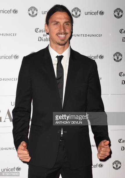 "Manchester United's Swedish striker Zlatan Ibrahimovic poses on the red carpet as he arrives to attend the ""United for UNICEF Gala Dinner"" at Old..."