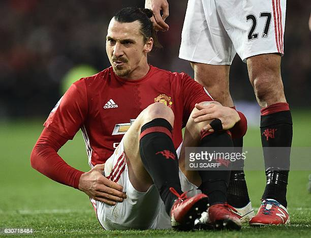 Manchester United's Swedish striker Zlatan Ibrahimovic reacts after clashing with Middlesbrough's Spanish goalkeeper Víctor Valdes during the English...