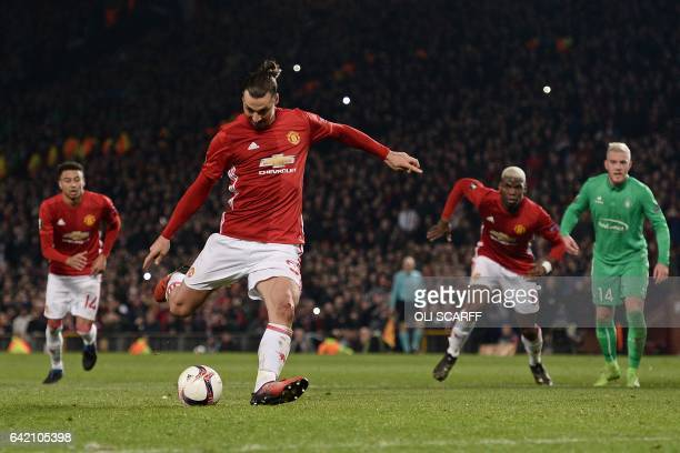 TOPSHOT Manchester United's Swedish striker Zlatan Ibrahimovic shoots from the penalty spot to score his team's third goal during the UEFA Europa...