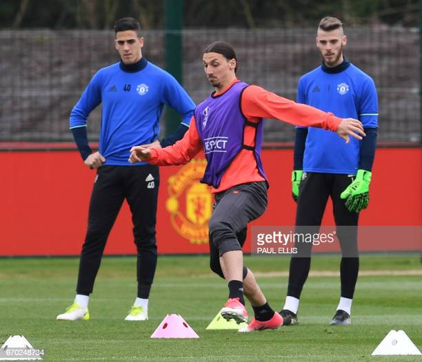 Manchester United's Swedish striker Zlatan Ibrahimovic takes part in an exercise as Manchester United's Swiss goalkeeper Joel Castro Pereira and...