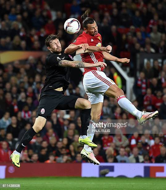 Manchester United's Swedish striker Zlatan Ibrahimovic vies in the air with Zorya's Belarusian defender Mikhail Sivakov as he heads the ball towards...