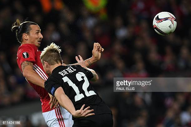 TOPSHOT Manchester United's Swedish striker Zlatan Ibrahimovic vies with Zorya's Brazilian defender Rafael Forster during the UEFA Europa League...