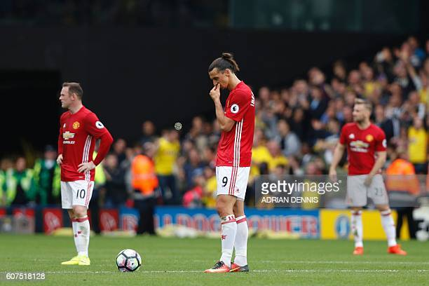 Manchester United's Swedish striker Zlatan Ibrahimovic waits to re-start the match after Watford scored their second goal during the English Premier...