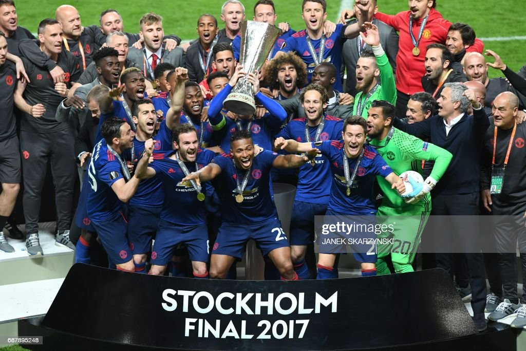 Manchester United's team celebrate with the trophy after they won the UEFA Europa League final football match Ajax Amsterdam v Manchester United on May 24, 2017 at the Friends Arena in Solna outside Stockholm. /