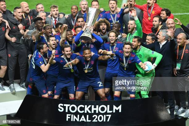 Manchester United's team celebrate with the trophy after they won the UEFA Europa League final football match Ajax Amsterdam v Manchester United on...