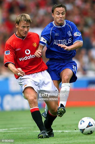 Manchester United's Teddy Sheringham challenges Chelsea's Dennis Wise during first half of the FA Charity Shield at Wembley stadium in London 13...
