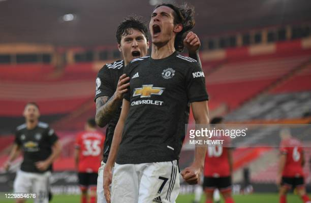 Manchester United's Uruguayan striker Edinson Cavani celebrates scoring their second goal with Manchester United's Swedish defender Victor Lindelof...