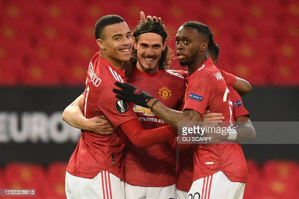 Manchester United's Uruguayan striker Edinson Cavani celebrates with teammates after scoring the opening goal of the UEFA Europa league quarter...