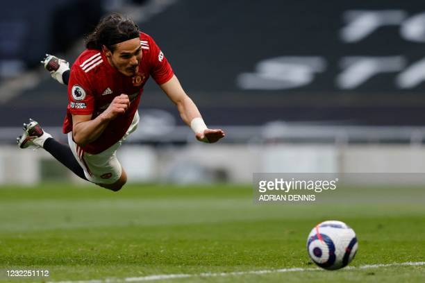 Manchester United's Uruguayan striker Edinson Cavani heads the ball and scores during the English Premier League football match between Tottenham...