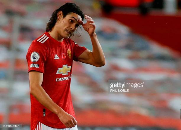 Manchester United's Uruguayan striker Edinson Cavani reacts at the end of the English Premier League football match between Manchester United and...