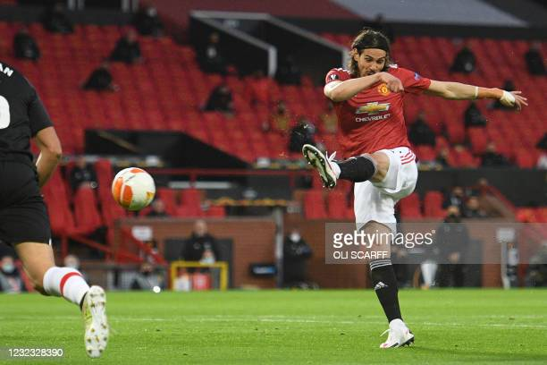 Manchester United's Uruguayan striker Edinson Cavani shoots to score the opening goal of the UEFA Europa league quarter final, second leg football...