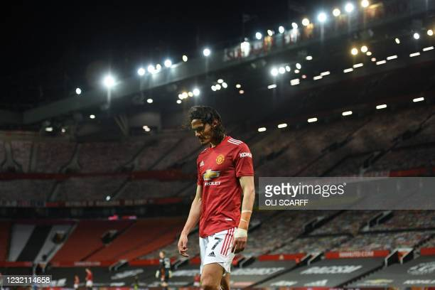 Manchester United's Uruguayan striker Edinson Cavani walks off the pitch after being substituted during the English Premier League football match...