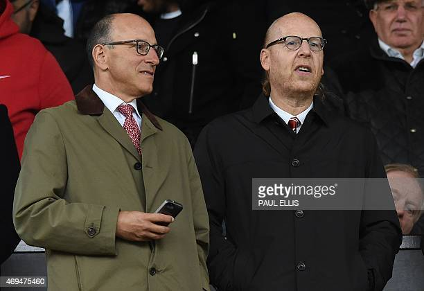Manchester United's US co-chairmen Joel Glazer and Avram Glazer attend the English Premier League football match between Manchester United and...