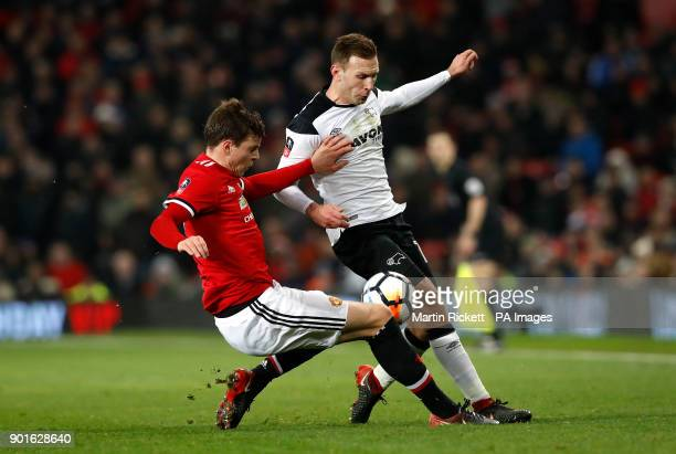 Manchester United's Victor Lindelof and Derby County's Andreas Weimann battle for the ball during the FA Cup third round match at Old Trafford...