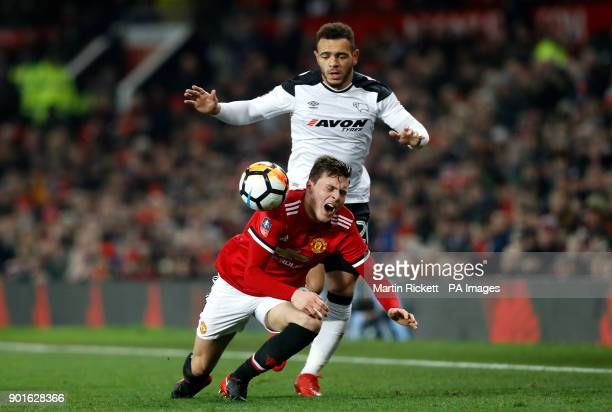 Manchester United's Victor Lindelof and Derby County's Mason Bennett battle for the ball during the FA Cup third round match at Old Trafford...