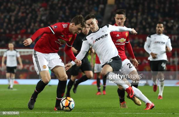 Manchester United's Victor Lindelof and Derby County's Tom Lawrence battle for the ball during the FA Cup third round match at Old Trafford Manchester