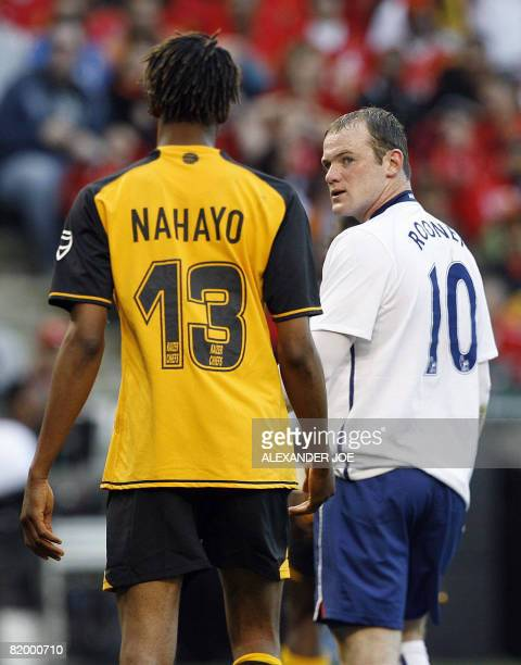 Manchester United's Wanyne Rooney eyes Kaizer Chiefs' Valery Nahayo during Vodacom Challenge Pre Season friendly at Newlands stadium in South Africa...