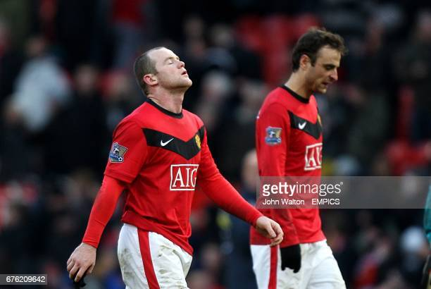 Manchester United's Wayne Rooney and Dimitar Berbatov walk off dejected after the final whistle