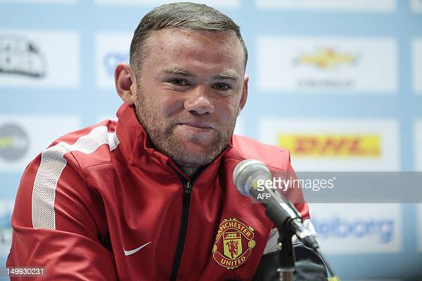 Manchester United's Wayne Rooney answers questions during a press conference in Goteborg on August 7 ahead of a friendly football match between...
