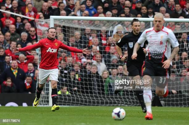 Manchester United's Wayne Rooney appeals to match referee Mark Clattenburg