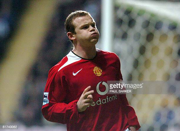 Manchester United's Wayne Rooney celebrares after scoring to make it 1-0 against Newcastle during today's Premiership clash at St James' Park,...