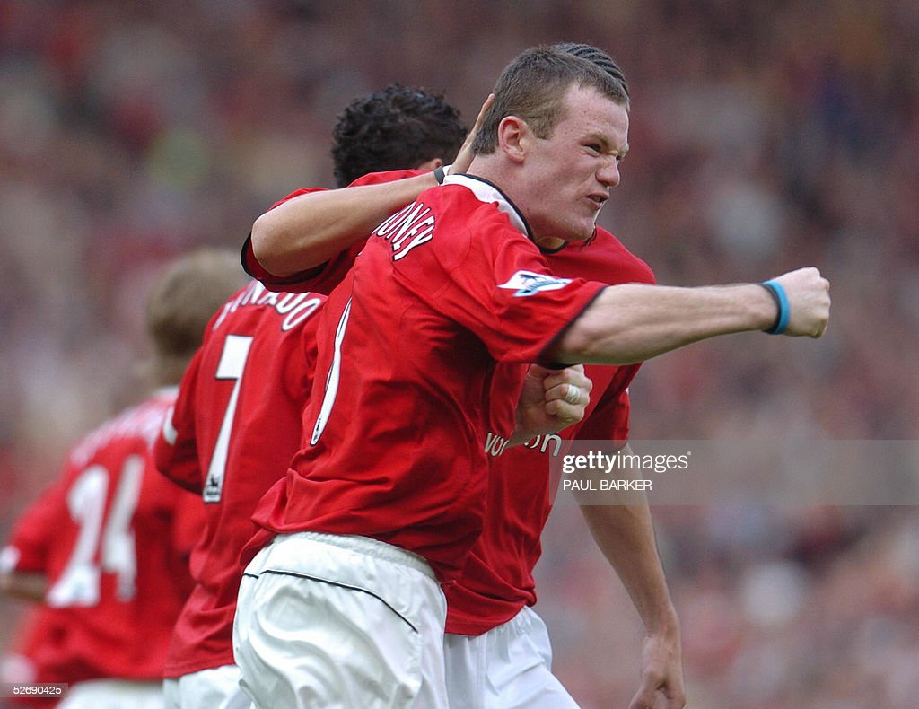 Manchester United's Wayne Rooney celebrates after scoring to make it 1-1 against Newcastle during a Premiereship match at Old Trafford, Manchester, United Kingdom 24 April 2005. AFP Photo by Paul Barker