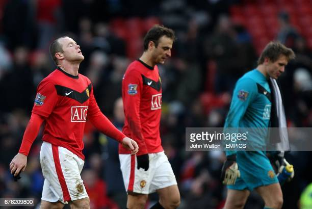 Manchester United's Wayne Rooney Dimitar Berbatov and Tomasz Kuszczak walk off dejected after the final whistle