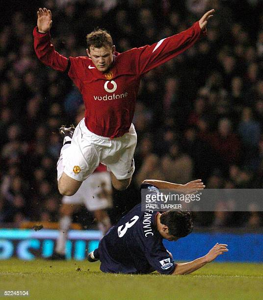 Manchester United's Wayne Rooney goes flying over Portsmouth's Dejan Stefanovic during their Premiereship football match at Old Trafford in...