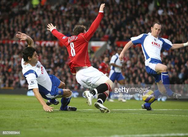 Manchester United's Wayne Rooney is fouled in the penalty box by Portsmouth's Dejan Stefanovic, resulting in a penalty