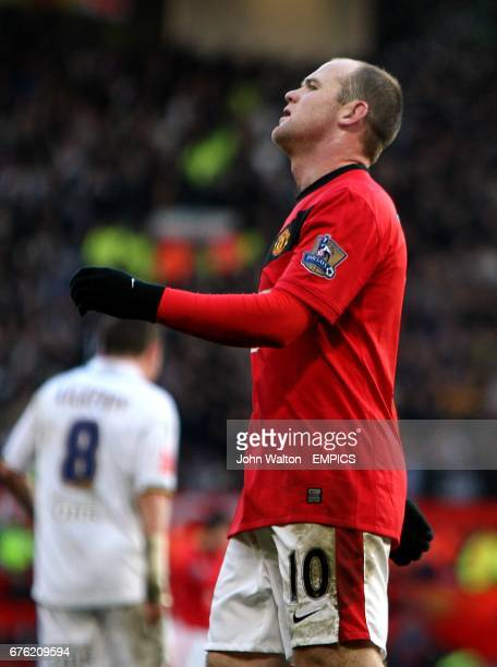 Manchester United's Wayne Rooney reacts after seeing his shot go over the bar