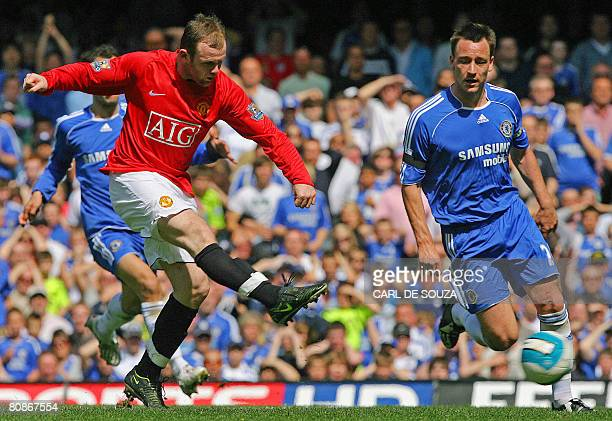 Manchester United's Wayne Rooney shoots past Chelsea's John Terry to score an equalising goal during their Premiership match at Stamford Bridge...