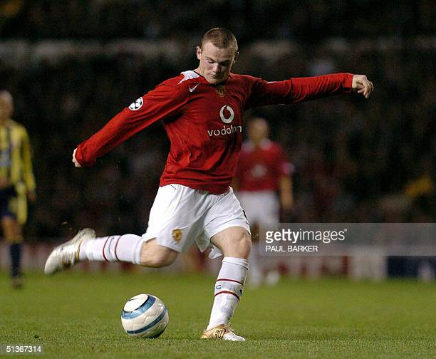Manchester United's Wayne Rooney shoots to score against Fenerbahce during their Champion's League football match at Old Trafford Manchester 28...
