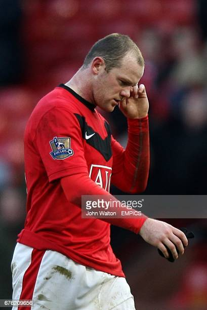 Manchester United's Wayne Rooney walk off dejected after the final whistle