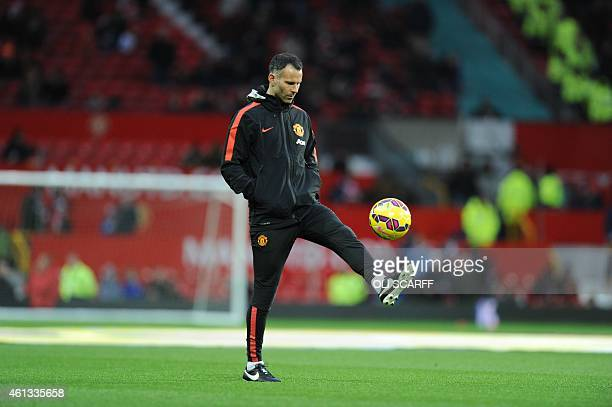 Manchester United's Welsh assistant manager Ryan Giggs joins the warm up ahead of the English Premier League football match between Manchester United...