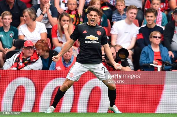 Manchester United's Welsh midfielder Daniel James celebrates scoring the opening goal during the English Premier League football match between...