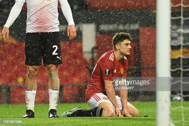 Manchester United's Welsh midfielder Daniel James reacts after missing a chance during the UEFA Europa League round of 16 first leg football match...