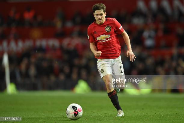 Manchester United's Welsh midfielder Daniel James runs with the ball during the English Premier League football match between Manchester United and...