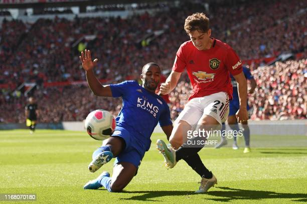 Manchester United's Welsh midfielder Daniel James vies with Leicester City's Portuguese defender Ricardo Pereira during the English Premier League...
