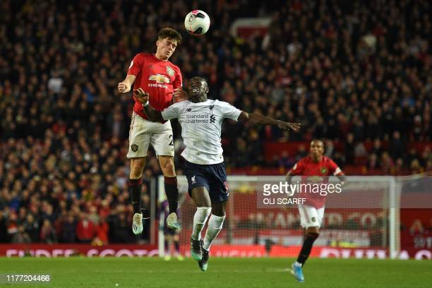 Manchester United's Welsh midfielder Daniel James vies with Liverpool's Senegalese striker Sadio Mane during the English Premier League football...