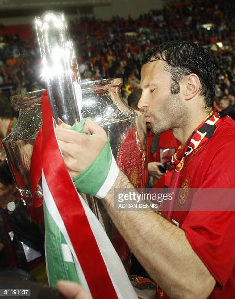 Manchester United's Welsh midfielder Ryan Giggs kisses the trophy after beating Chelsea in the final of the UEFA Champions League football match at...